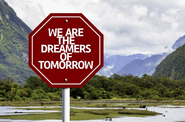 We Are The Dreamers Of Tomorrow written on red road sign